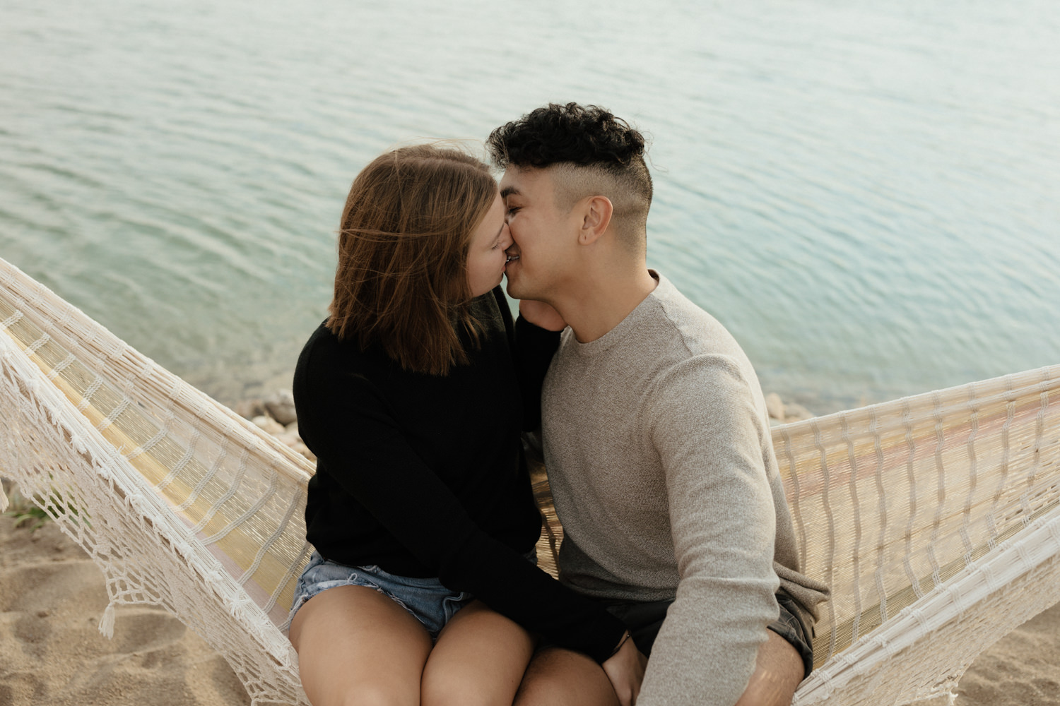 Summer couple session in a hammock on a beach and swimming in a lake