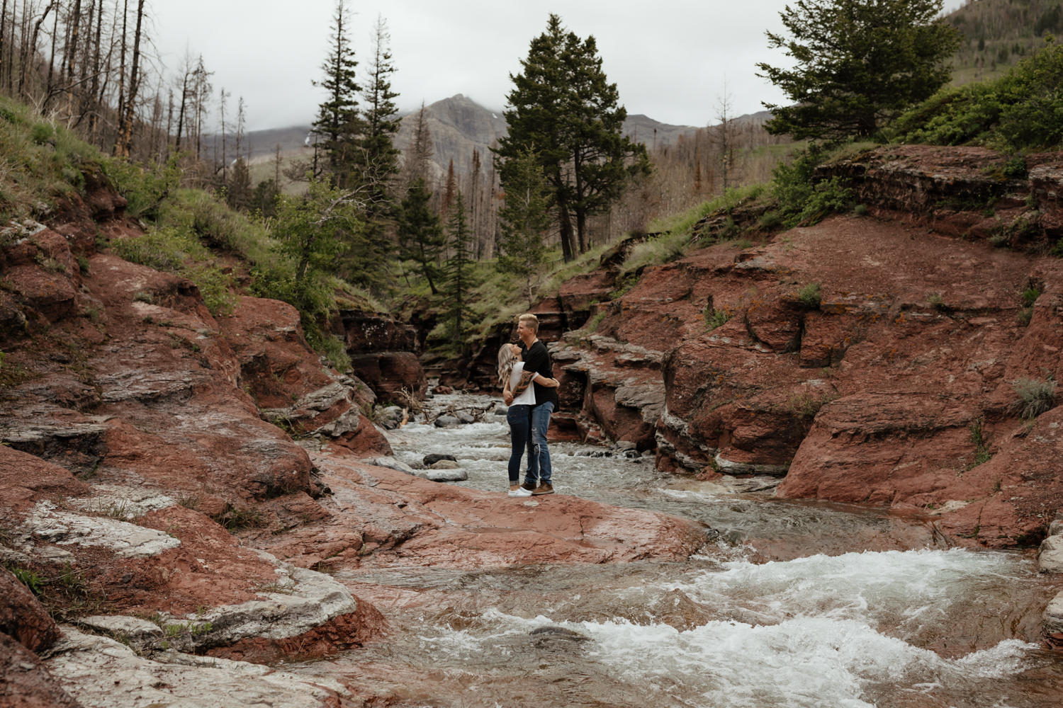 Couple Photos at Red Rock Canyon in Waterton Lakes National Park