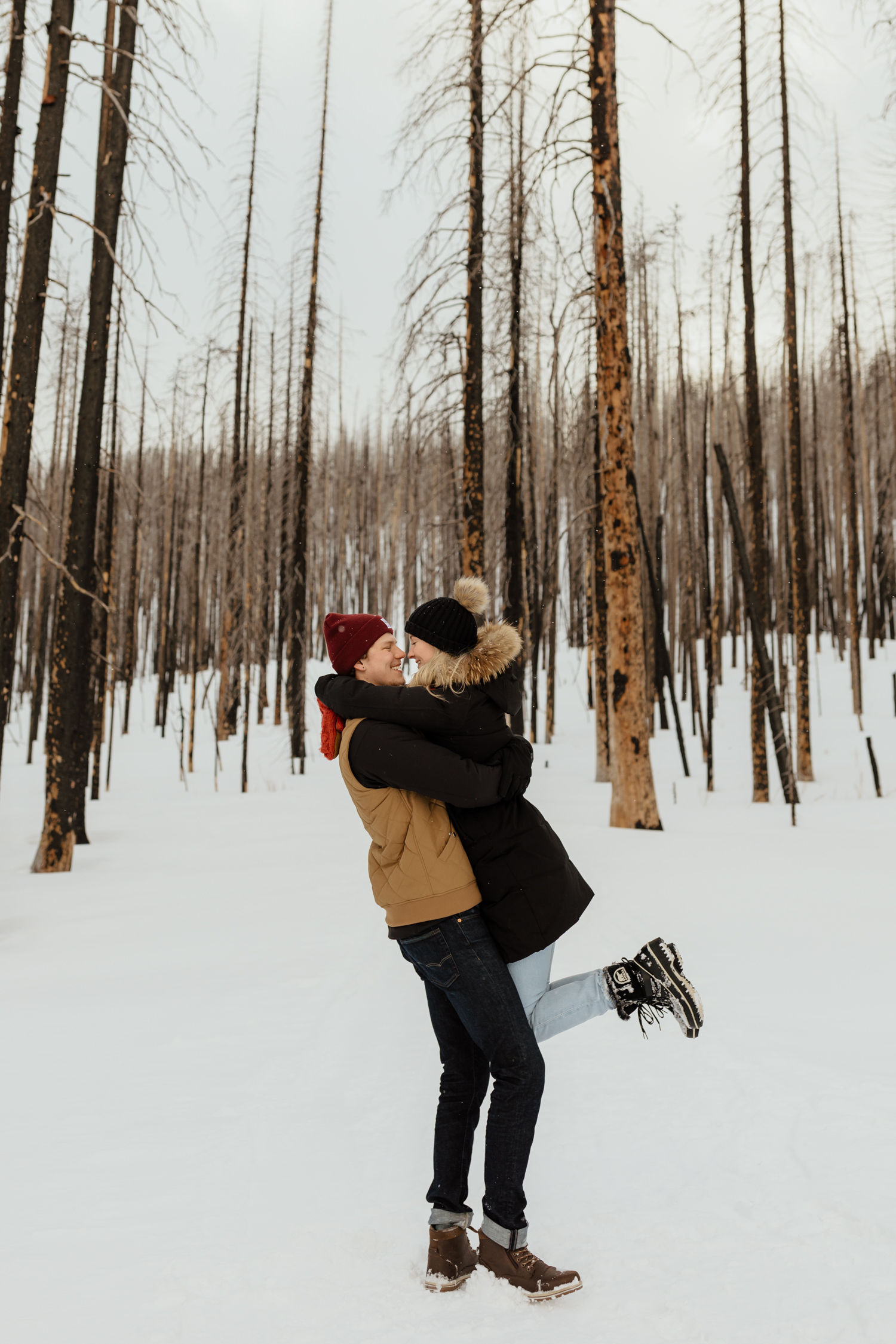 Snowy surprise proposal and engagement photos in Waterton Lakes National Park.